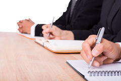 Businessman and Businesswoman take note Stock Images