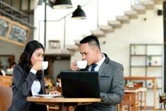 Businessman and businesswoman taking a coffee break Stock Photos
