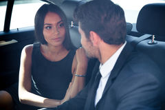 Businessman and businesswoman talking in car Stock Photo