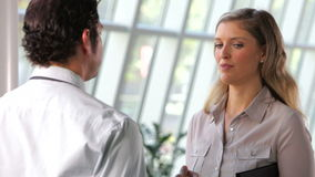 Businessman And Businesswoman Talking In Office stock footage