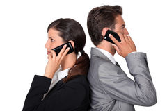 Businessman and businesswoman telephoning Royalty Free Stock Photography