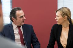 Businessman And Businesswoman In Mediation Meeting. Businessman And Businesswoman Together In Mediation Meeting Stock Photography