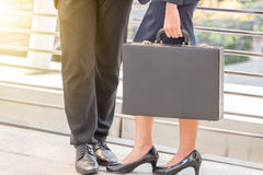 Businessman and businesswoman traveler with luggage at city background. Business People Commuter Walking City Life Concept Royalty Free Stock Image