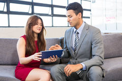Businessman and businesswoman using digital tablet Royalty Free Stock Image