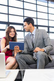 Businessman and businesswoman using digital tablet Stock Images