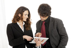Businessman and businesswoman using a tablet computer Stock Photo