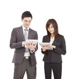 Businessman and businesswoman using tablet pc Royalty Free Stock Image