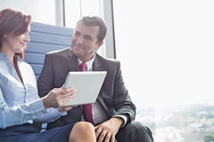 Businessman and businesswoman using tablet PC in office Royalty Free Stock Photography