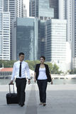Businessman and Businesswoman Walking Royalty Free Stock Photo