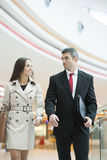 Businessman and businesswoman walking together Stock Image