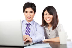 Businessman and Businesswoman at Work Stock Image