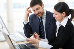 Businessman and businesswoman working. Royalty Free Stock Image