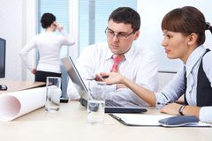 Businessman and businesswoman working in office Royalty Free Stock Image