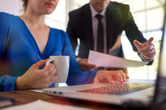 Businessman And Businesswoman Working In Office Together In Coop Royalty Free Stock Images