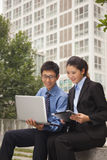 Businessman and businesswoman working outdoors Stock Photos