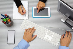 Businessman in businesswoman working together in office. Using t Stock Photo