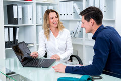 Businessman and businesswoman working together in the office Royalty Free Stock Photos