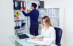 Businessman and businesswoman working together in the office Stock Images