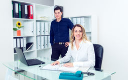 Businessman and businesswoman working together in the office Royalty Free Stock Images
