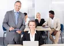 Businessman And Businesswoman Working Together Royalty Free Stock Images