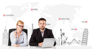 Businessman and businesswoman with world map and major landmarks Stock Photos