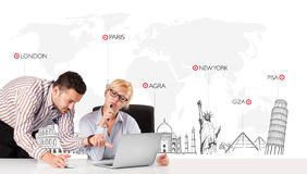Businessman and businesswoman with world map and major landmarks Stock Photo
