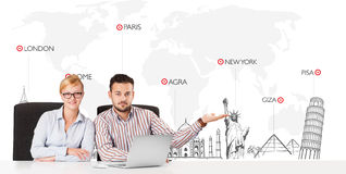 Businessman and businesswoman with world map and major landmarks Stock Image