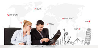 Businessman and businesswoman with world map and major landmarks Royalty Free Stock Photo
