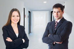 Businessman  and businesswomani in a corridor Royalty Free Stock Images