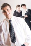 Businessman and businesswomen. Young businessman and two businesswomen Stock Photography