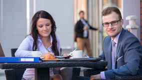 Businessman and businesswomen having a meeting in cafe. Stock Photos