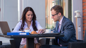 Businessman and businesswomen having a meeting in cafe. Royalty Free Stock Images