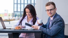 Businessman and businesswomen having a meeting in cafe. Stock Photo