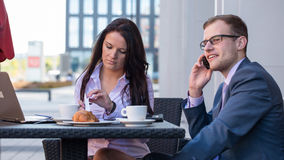 Businessman and businesswomen having a meeting in cafe. Royalty Free Stock Image