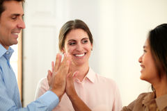 Businessman and businesswomen huddle their hands Royalty Free Stock Photos