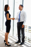 Businessman And Businesswomen Shaking Hands Royalty Free Stock Image