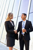 Businessman And Businesswomen Shaking Hands Outside Office Royalty Free Stock Images