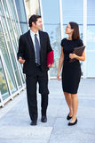 Businessman And Businesswomen Walking Outside Office Stock Photos