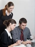 Businessman and businesswomen working. Businessman and two businesswomen working Royalty Free Stock Photo