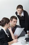 Businessman and businesswomen working. Businessman and two businesswomen working Royalty Free Stock Image