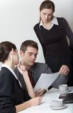 Businessman and businesswomen working. Businessman and two businesswomen working Royalty Free Stock Photos