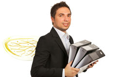 Businessman busy as a bee with folders. Business man busy as a bee holding folders isolated on white background Royalty Free Stock Images