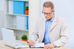 Businessman is busy doing paperwork Stock Images
