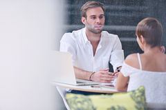 Businessman busy interviewing potential female employee to work for him Royalty Free Stock Photos