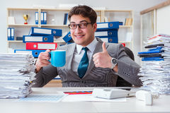 The businessman busy with much paperwork. Businessman busy with much paperwork Royalty Free Stock Photo