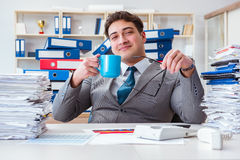 The businessman busy with much paperwork. Businessman busy with much paperwork Stock Image