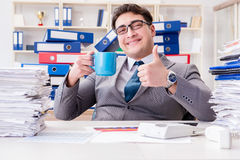 The businessman busy with much paperwork. Businessman busy with much paperwork Stock Photography