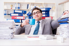 The businessman busy with much paperwork. Businessman busy with much paperwork Stock Images