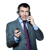 Businessman busy with multiple telephone Royalty Free Stock Photo