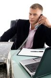 Businessman busy on phone Royalty Free Stock Images